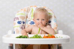 Baby girl eating raw food